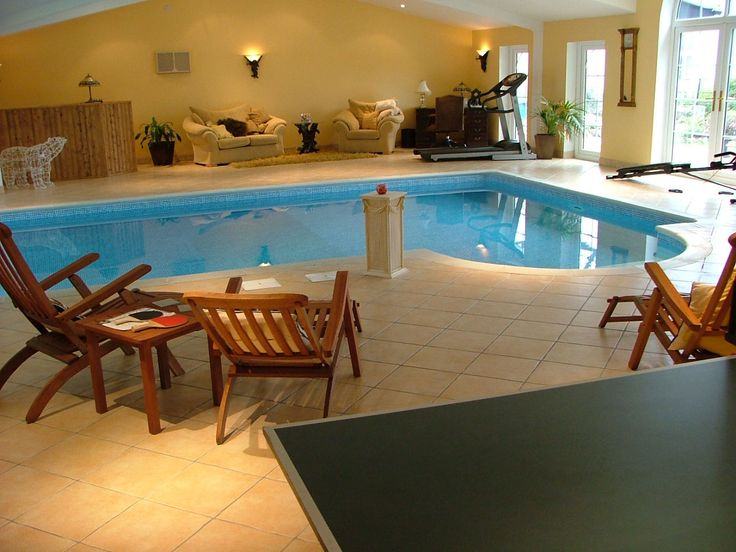 Decorating, Small Indoor Swimming Pool Designs With Wood Sofas And Chairs  Also Wall Lighting Ideas: The Best Of Luxury Indoor Swimming Pools.