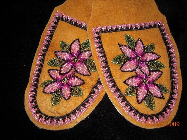 Women's moccasin/slipper tops on moosehide, Alaska native beadwork. By Liisia Carlo Edwardsen