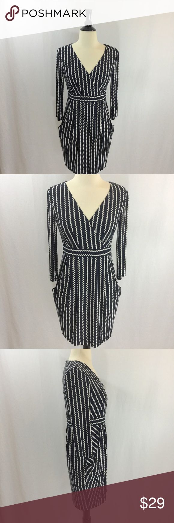Maggy London Petites navy and cream striped dress Gorgeous navy and cream zigzag striped petite dress with pockets. Back zip, fully lined. Size 4P from Maggy London Petites. Approximately 33 inches long, 16.5 inches armpit to armpit, 27 inch waist, 36 inch hips, 14.5 inch shoulders, 17 inch sleeves. Offers welcome. Thanks for shopping my closet! Maggy London Dresses Long Sleeve
