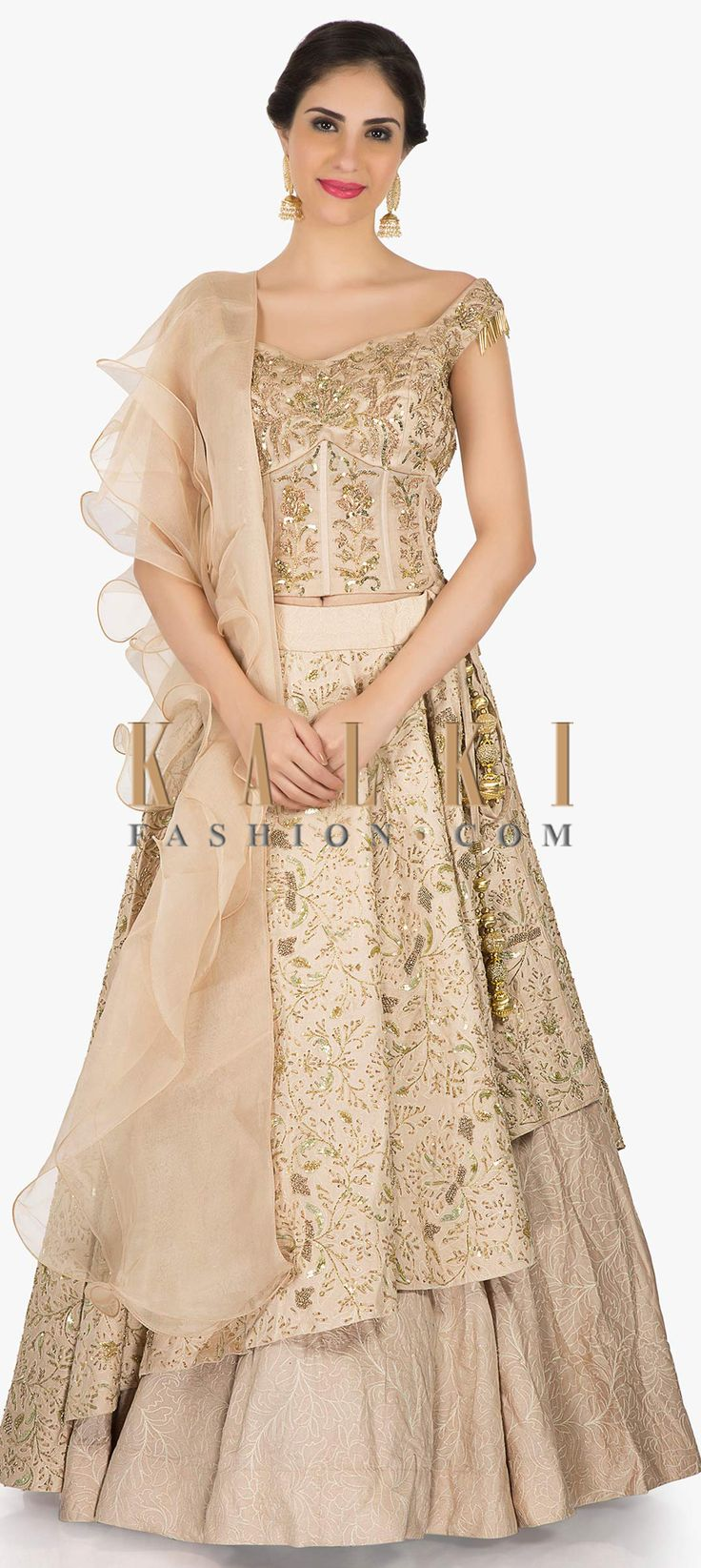 Buy Online from the link below. We ship worldwide (Free Shipping over US$100)  Click Anywhere to Tag Beige Lehenga in silk beautified with zardosi and sequin work only on Kalki Look all hatke in your sister's reception party by wearing this beige lehenga and top. The skirt and top in silk is beautified using the zardosi and sequin embroidery work. The corset blouse displays fancy tassels at the sleeves. The dupatta will definitely grab attention with its frill design that it exhibits.