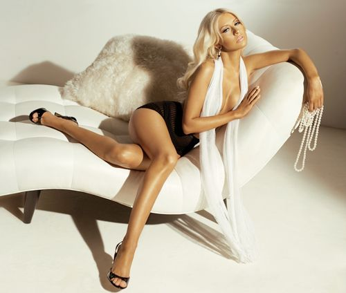 sexy boudoir pose, draped over the couch holding pearls #christina_aguilera