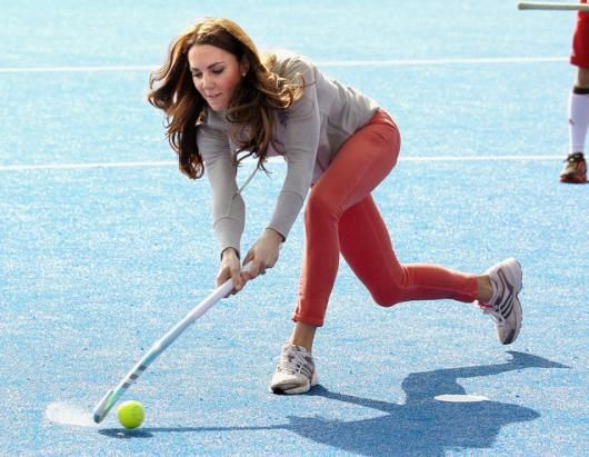 Kate Middleton, Duchess of Cambridge, plays hockey with the GB hockey teams at the Riverside Arena in the Olympic Park, March 15, 2012 in London. The Duchess viewed the Olympic park and met members of the mens and womens GB Hockey teams.  (Chris Jackson/WPA/Getty Images)