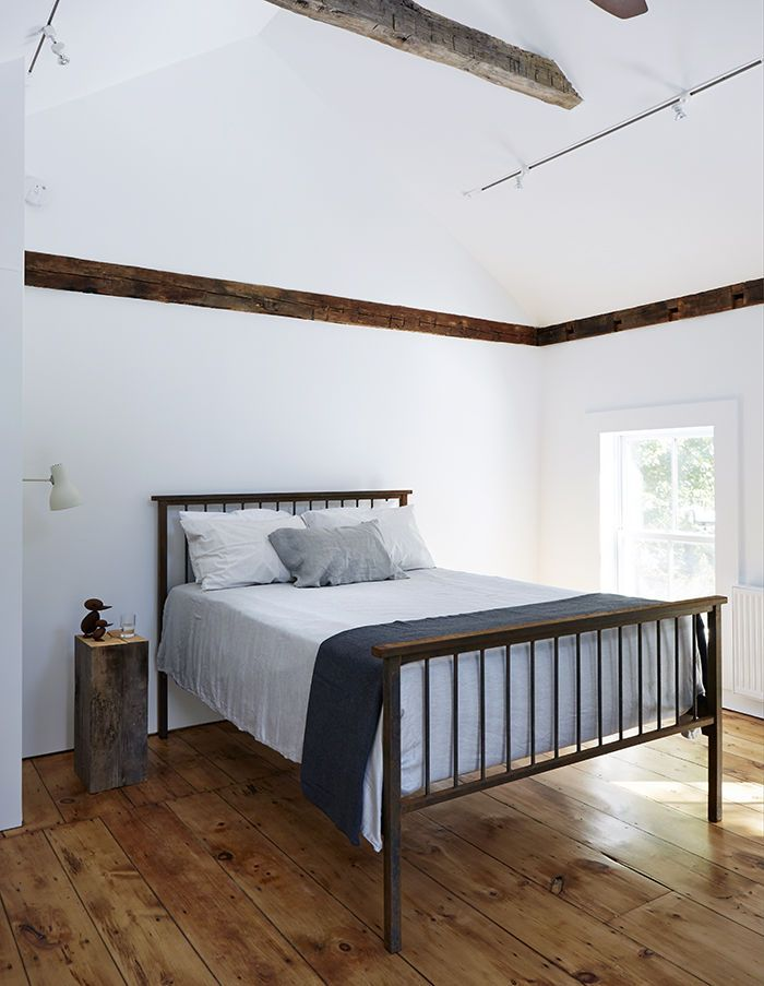 Master bedroom with wood floors and exposed