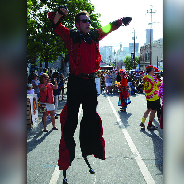 One of our performers Mike, jumping for joy at this great street festival!!   #jumpingStilts #Stilts #Stiltwalking #TheImperialOPA #Circus #Atlanta #OPA #AtlantaCircus ------------- #1 rated entertainment booking company in GA!   Contact us today and lets make unforgettable events together!