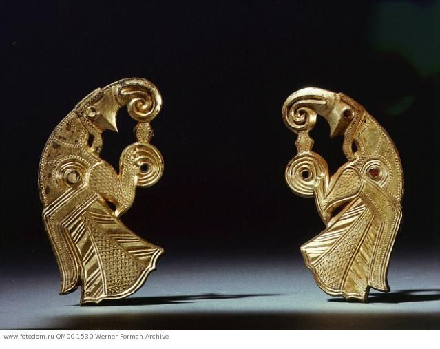 Odin's birds, a pair of harness mounts from Gotland. The exaggerated beaks and talons emphasize the ferocity of the eagles which were widely associated with the cult of Odin. Country of Origin: Sweden. Culture: Viking. Place of Origin: Vallstenarum, Vallstena parish. Material Size: gilt-bronze. Credit Line: Werner Forman Archive/ Statens Historiska Museum, Stockholm . Location: 18.