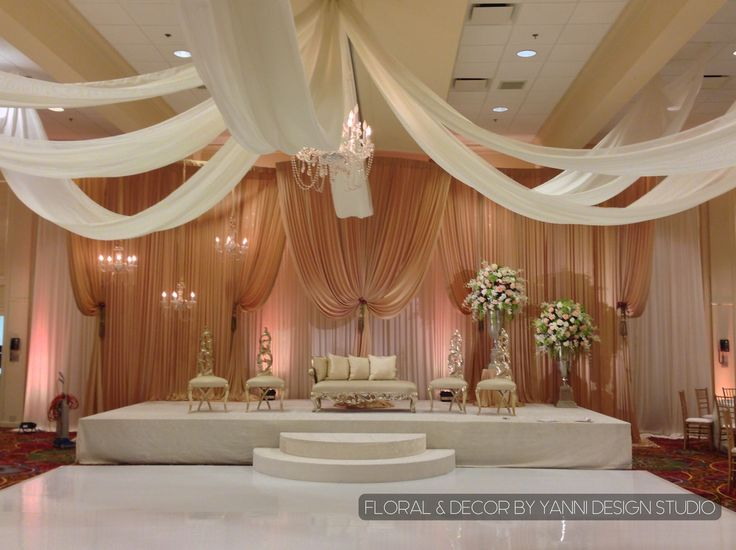 14 best marriott lincolnshire hotel wedding decor images on south asian wedding stage decor includes luxurious furniture a peach backdrop and a white junglespirit Gallery