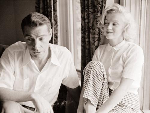 Joe Dimaggio & Marilyn Monroe. I love how she is watching him.