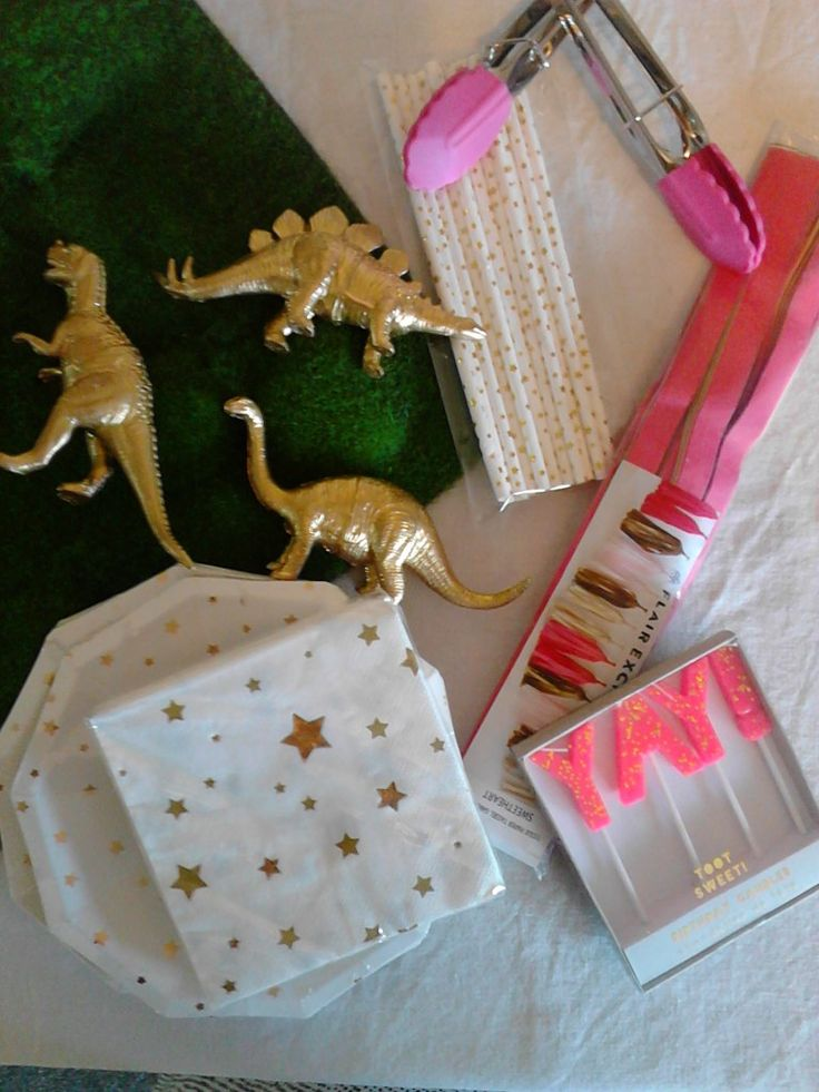 Mila's pink and gold dinosaur party supplies