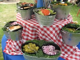 summer buffet setup . . . love the way the table is elevated .