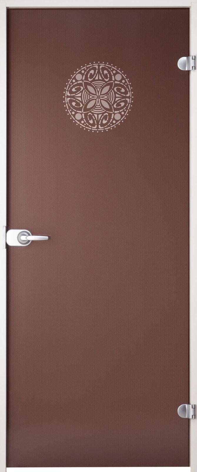 Kylppärin ovi itämaisella ornamenttikuviolla. Ovi on valmistettu 8 mm paksuisesta turvalasista. - Bathroom door with oriental effect. Door is made of 8 mm thick safety glass.