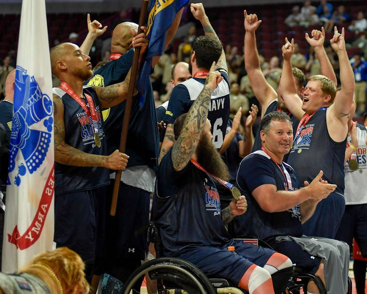 Team Navy celebrates after winning the 2017 Warrior Games' sitting volleyball medal rounds at the United Center.