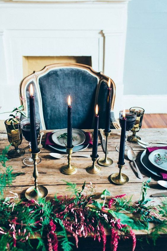36 Ideas To Throw A Halloween Wedding With Style: #2. Black candles and moody florals for the refined tablescape