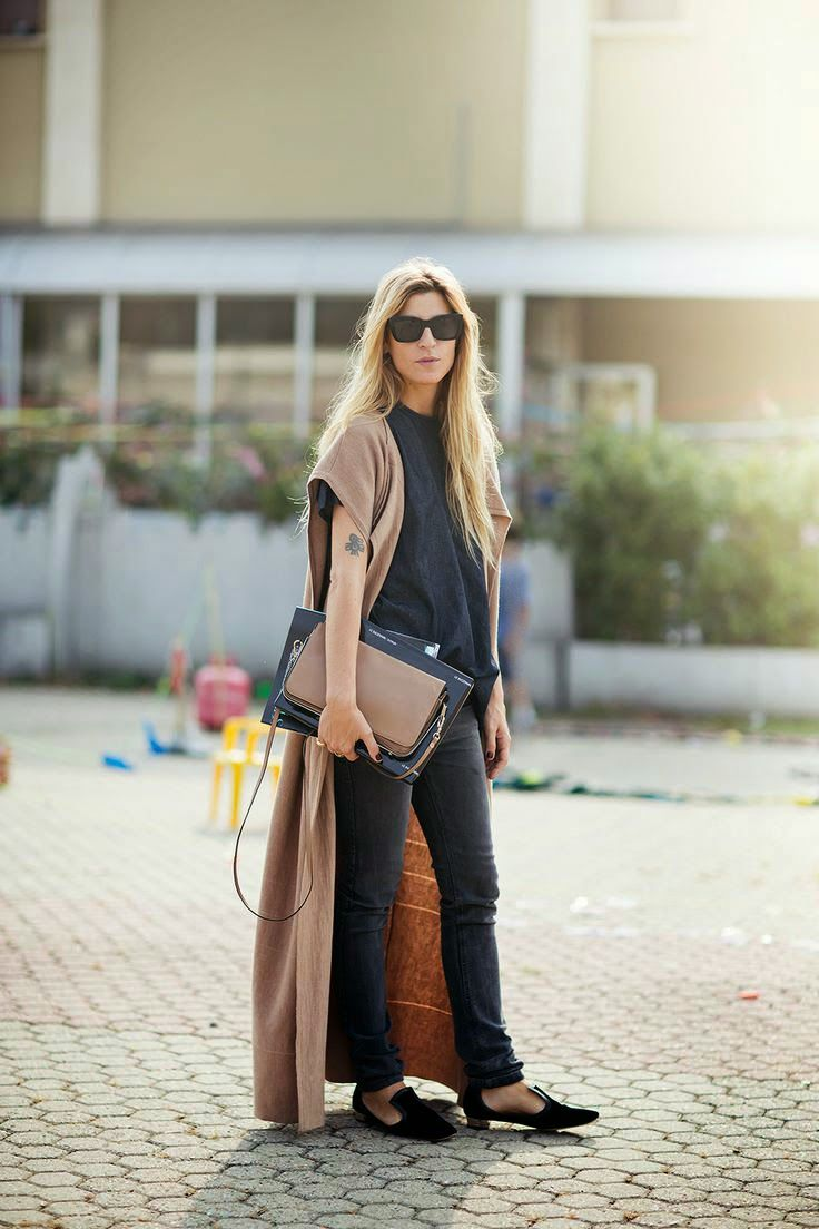Black blouse with brown long cardigan and brown leather hand bag and grey casual jeans and black cute pumps