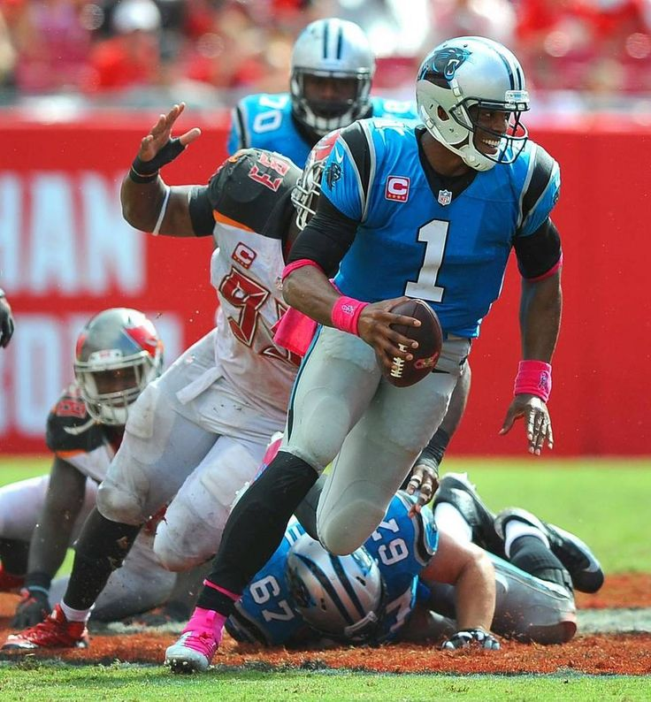 Carolina Panthers quarterback Cam Newton rushes for yardage vs the Tampa Bay Buccaneers during fourth quarter action on Sunday, October 4, 2015 at Raymond James Stadium in Tampa, Fl. The Panthers defeated the Buccaneers 37-23.