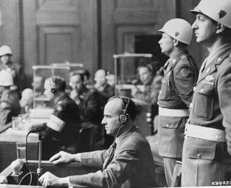 """On trial at Nuremberg     Hans Franc at Nuremburg Trails """"The Jews must be eliminated. Whenever we catch one, it is his end""""....""""This territory [Poland] is in its entirety the booty of the German Reich""""....""""I have not been hesitant in declaring that when a German is shot, up to 100 Poles shall be shot too.""""--from the diary of Hans Frank."""