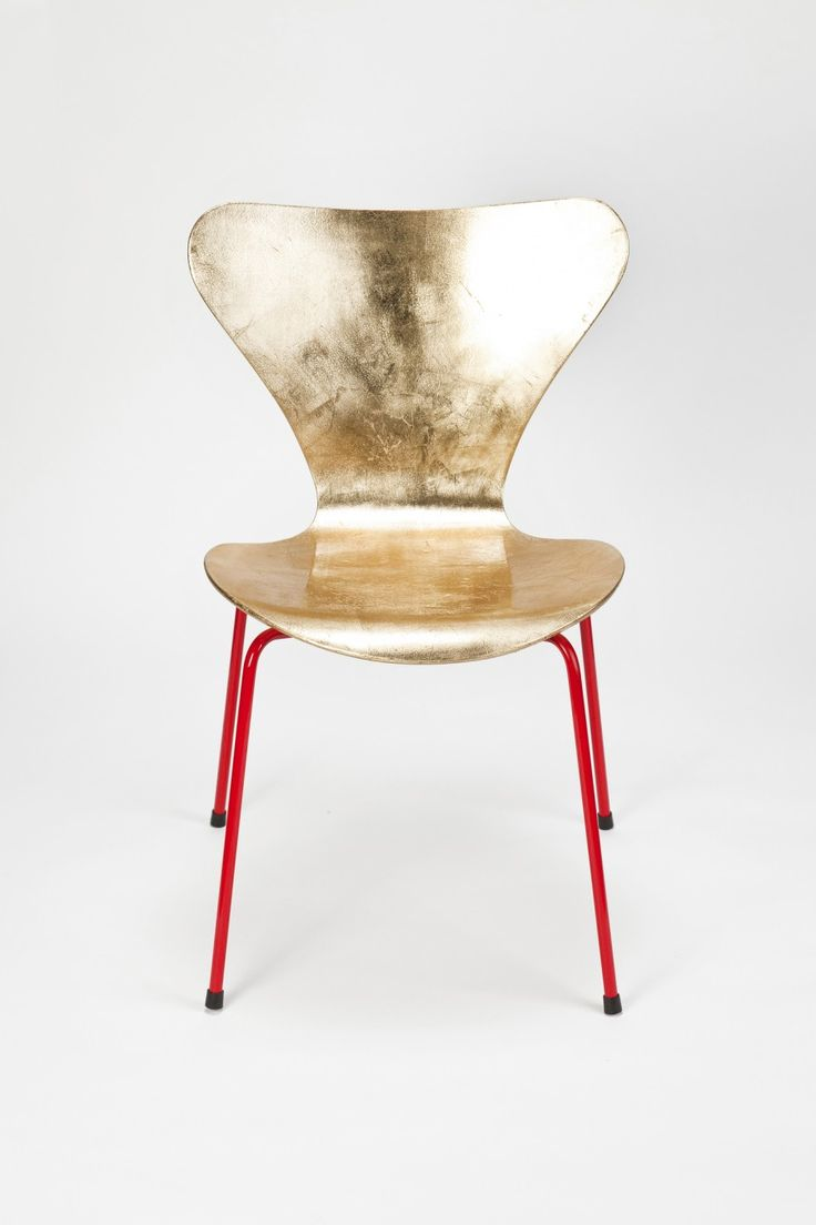 Arne Jacobsen Golden Chair, gold leaf, plywood, laquered metal, designer Arne Jacobsen/Reha Okay, Manufacturer Fritz Hansen/okay art. Owner of Basel-based vintage furniture gallery okay art, Reha Okay offers a limited production of vintage Eames and Jacobsen iconic chairs with a beautiful red base and shinny gold seating. Each piece is hand-gilded then varnished, several times polished and base-lacquered by a car painter.