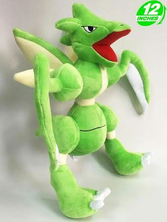 Pokemon Scyther Plush  Make Scyther part of your Pokemon team! These large plushes include its powerful blade-like forearms and wings that make it so powerful in battle.  - Plush is approximately 30 cm / 12 inches tall. - Brand new with tags. - Ages 6 & up.