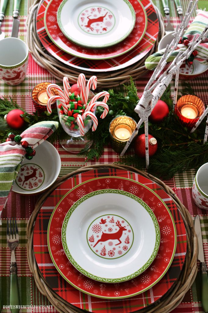 Cheery Checks, Merry Plaids and Whimsical Reindeer Christmas Table in red and green | homeiswheretheboatis.net #Christmas #tablescape