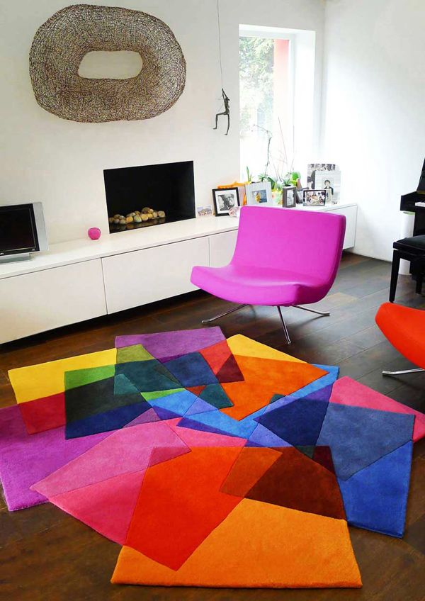 Living room idea with pink chair and colorful rugs.  #MaisonMatiere #Home #Decor