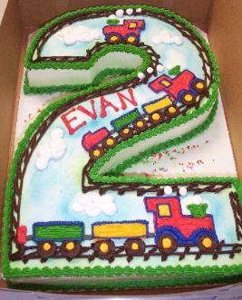 "Put the plane, train and automobile on a ""2"" shaped cake?"