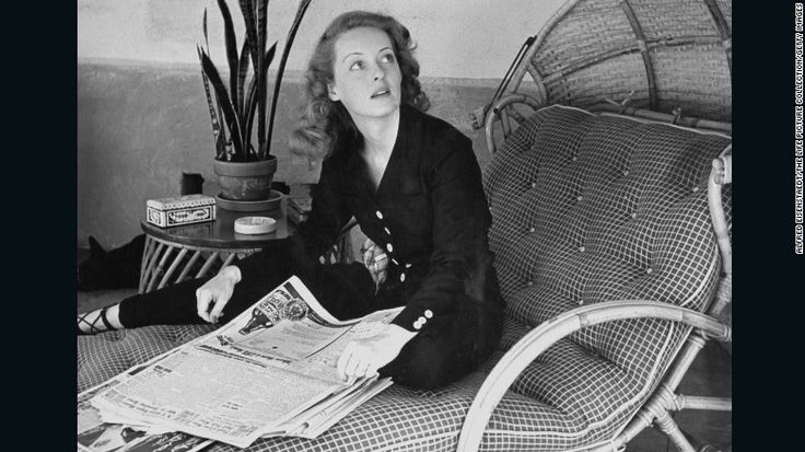 "Davis scans the morning papers during a photo shoot for Life magazine in 1939.  That year, she starred in four movies -- ""Dark Victory,"" ""The Old Maid,"" ""Juarez"" and ""The Private Lives of Elizabeth and Essex."" She became known as ""the first lady of the screen"" and was a top box-office star. ""Juarez"" co-star Brian Aherne would later write in his memoir, ""Surely nobody but a mother could have loved Bette Davis at the height of he..."