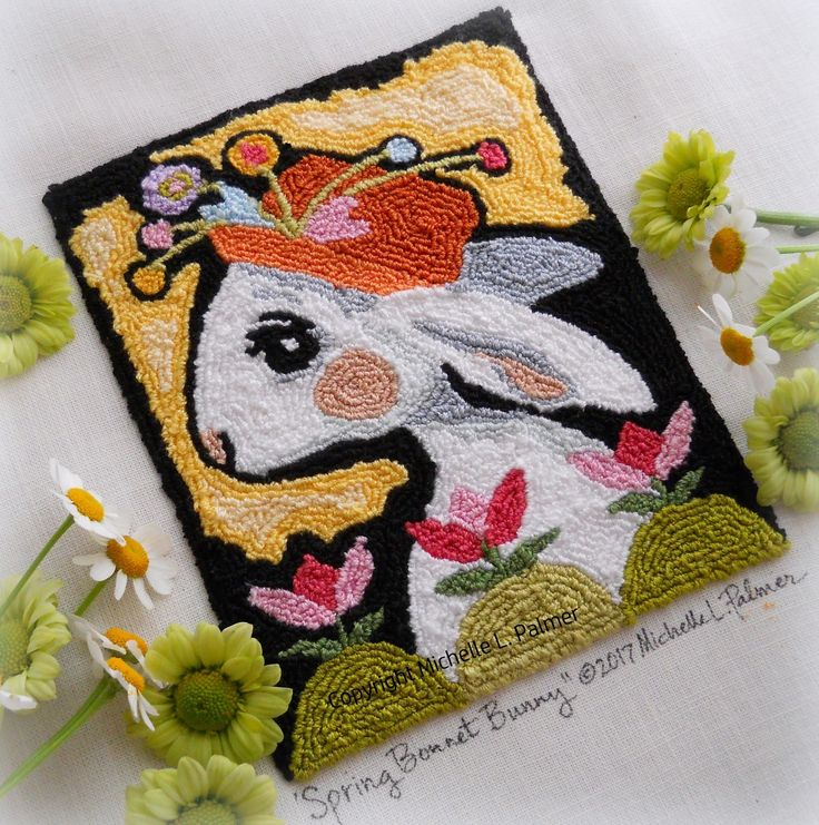 Petals & Palettes Michelle Palmer punch needle pattern. White bunny with her Spring bonnet~ she's enjoying her stroll through the tulip patch! DMC floss. Fiber art, embroidery