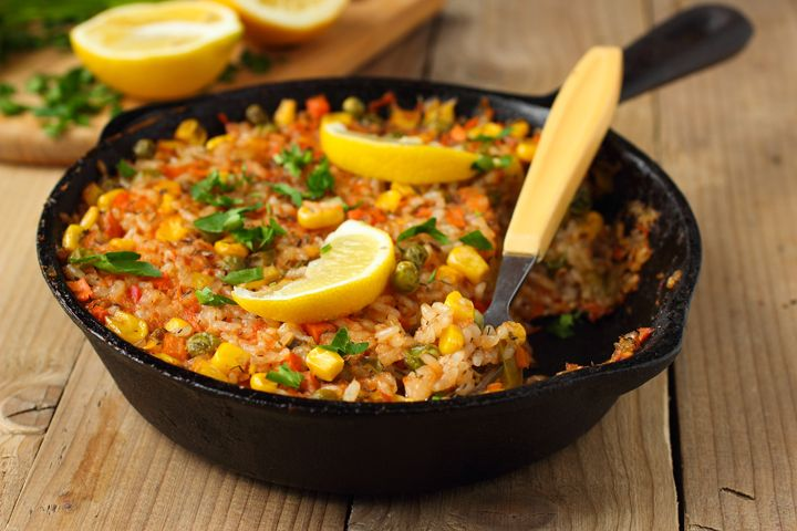 Vegan Paella: Yes, paella can be good for you! Try this vegan recipe for your next dinner party.