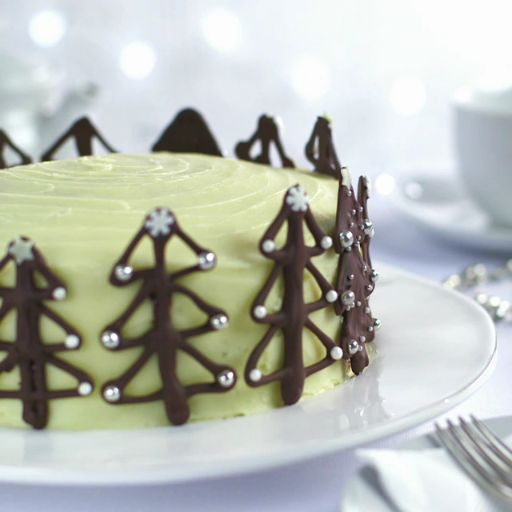 How to make Christmas tree cake decorations. Get creative this Christmas with this easy chocolate decoration idea for an alternative Christmas cake. All you need is some melted chocolate and festive sprinkles, then you can try different Christmas tree designs for a gorgeous-looking, and delicious-tasting, decoration. | Tesco