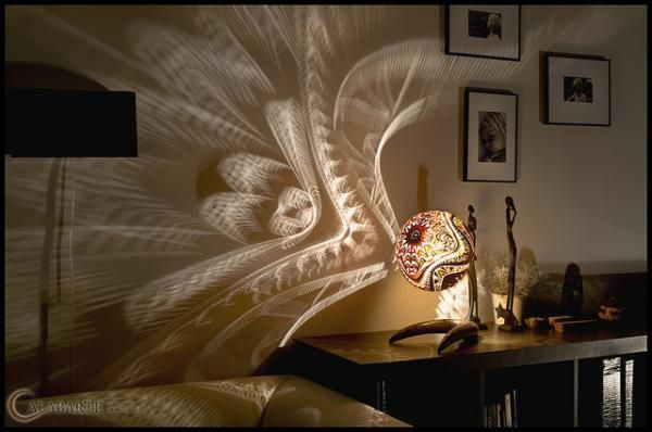 This stunning light is sculpted by Calabarte - an artist who carves elaborate pattern into gourds which come from Senegal.  Highly original