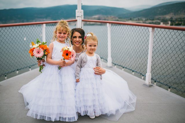 Bride and Flower girls on the Bow -  Photo by Justine Russo