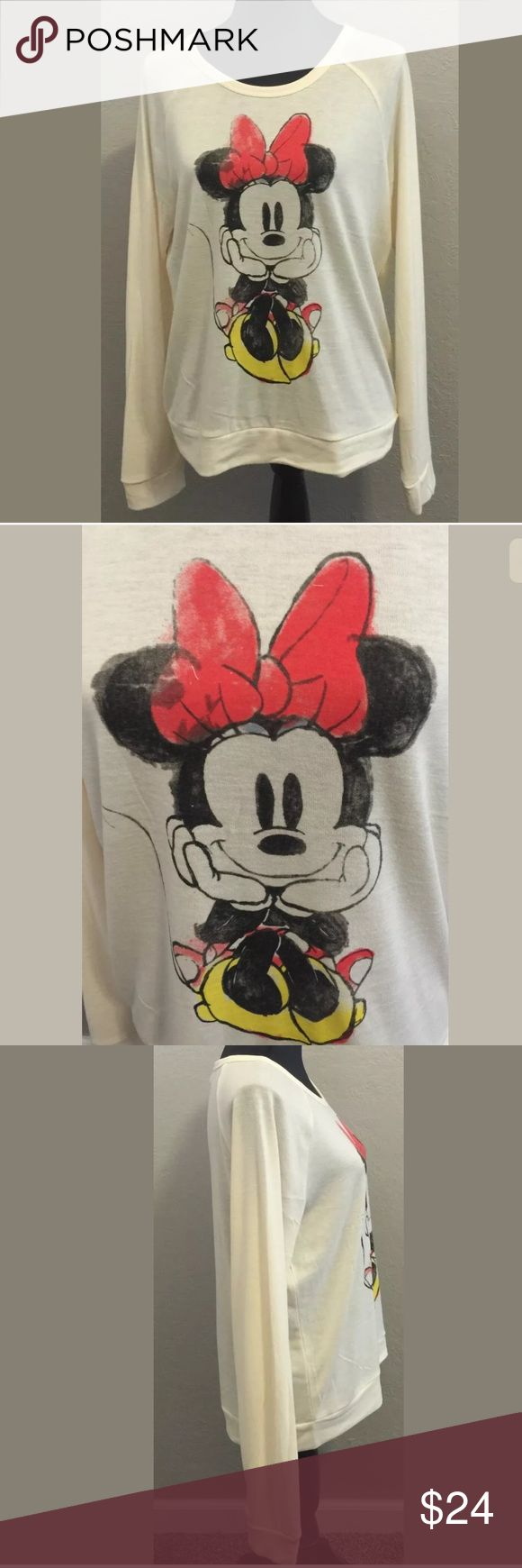 """Disney Minnie Mouse Jr large cream long sleeve top New without tags Disney Jr large Minnie Mouse long sleeve top. Polyester, Rayon, Spandex. Soft. Looks like water colors. Bust 21"""" armpit to armpit. Length 24"""" shoulder to hem. Sleeve 28"""" . Measurements are approximate. Disney Tops Tees - Long Sleeve"""