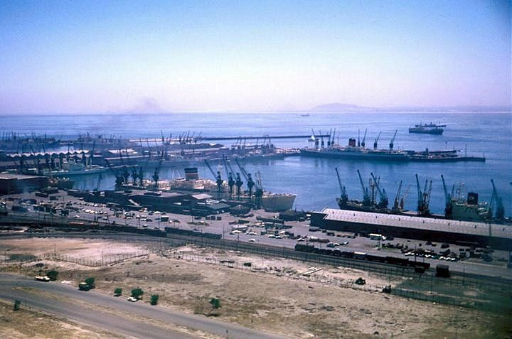 Cape Town docks in 1970, could be the Windsor Castle mail ship docked at A berth and a safmarine vessel as F berth. Note how undeveloped the city is at that time.