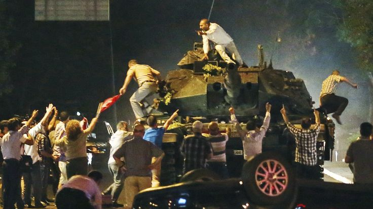 A tank moves into position as Turkish people attempt to stop it early Saturday in Ankara, Turkey. (AP)