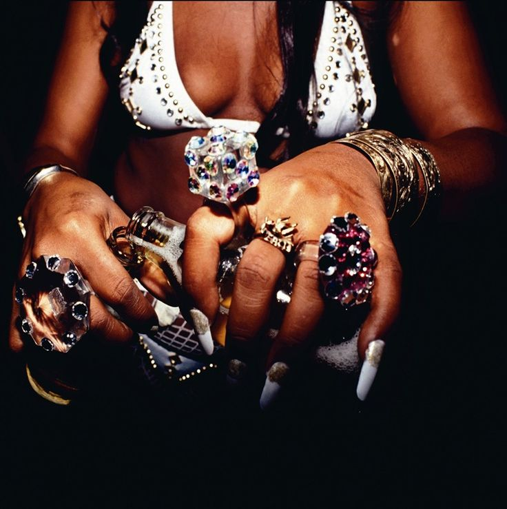 Raggamuffin's embracing of excess – as typified by this woman's jewellery and her rhinestone-patterned bra top – was, among black cultures, the antithesis of Rasta.