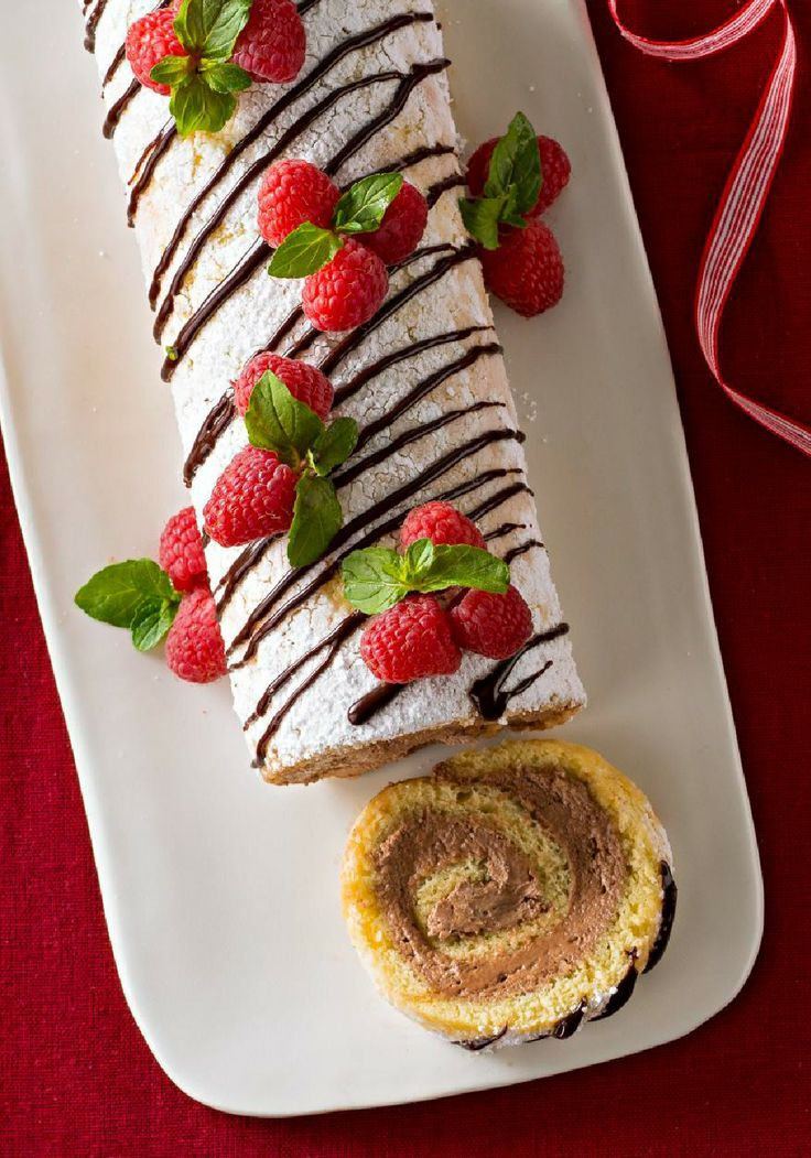 Holiday Cake Roll – Everyone loves a holiday Yule log! Especially when it's made with yellow cake and a creamy chocolate filling and festooned with festive mint and berries.