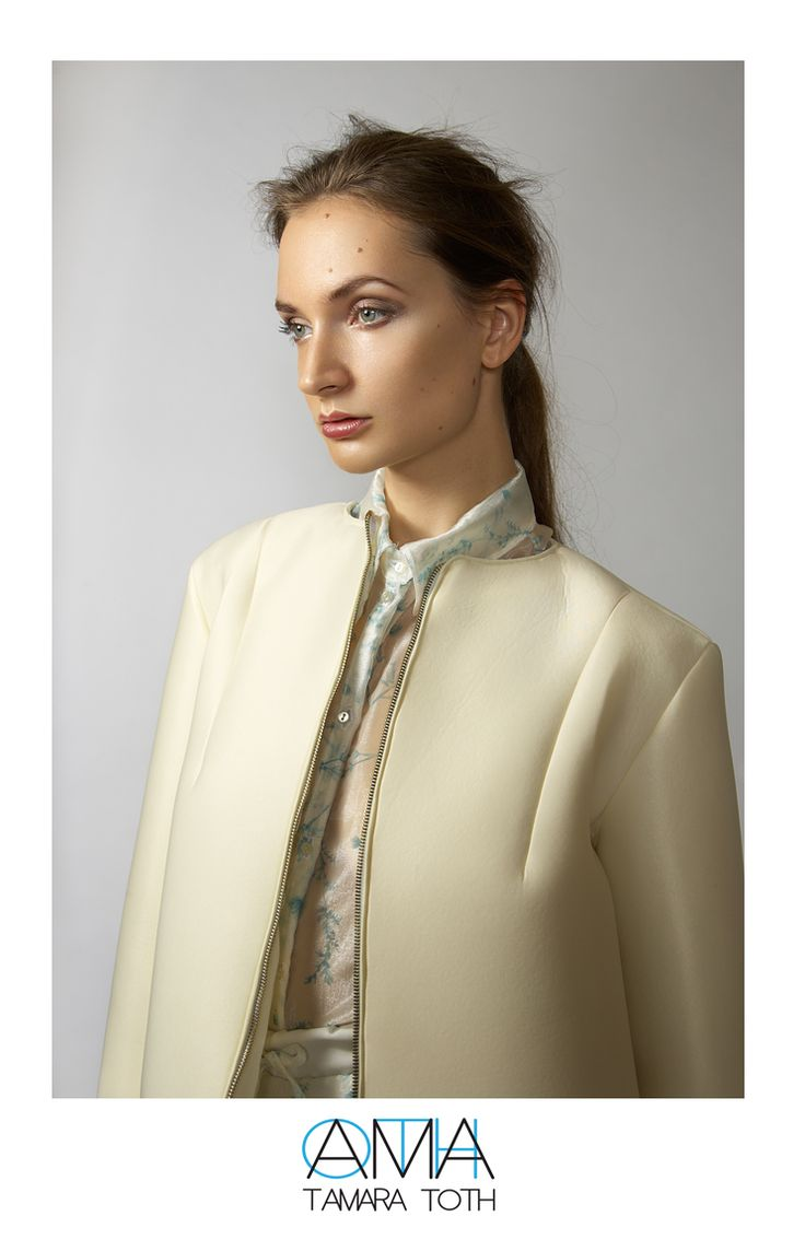 Special fabric coat and transparent cropped shirt.