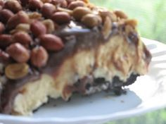 My family's new favorite dessert!  My recipe doesn't call for butter in the chocolate fudge layer and I put the peanuts between the ice cream and the fudge!  It is AWESOME!