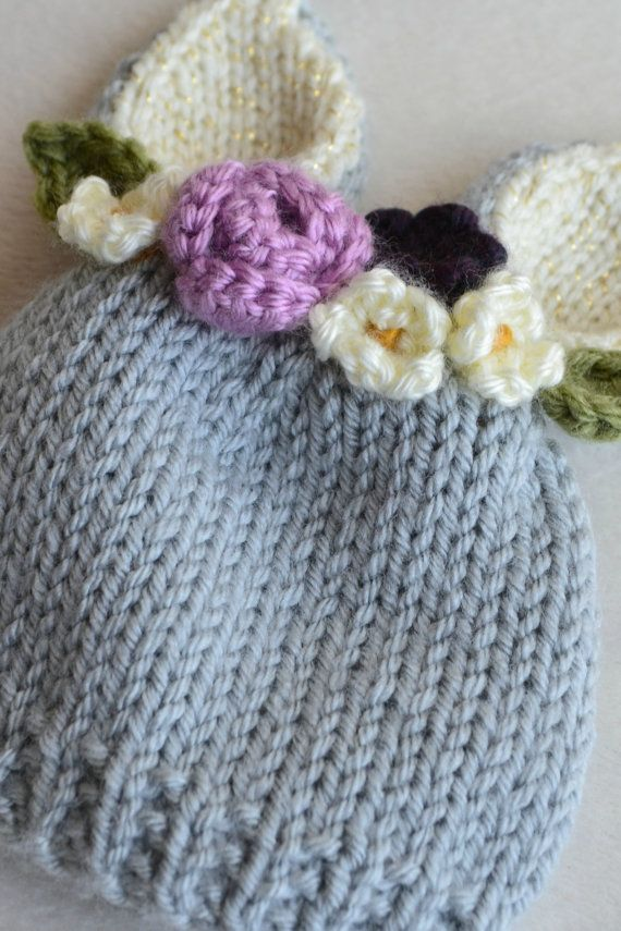Nothing says spring to me more than bunnies and flowers! And this little hat has both! 6-12 month size bunny hat with a floral crown look attached. Made with soft gray acrylic yarn, cream with a little gold sparkle in the bunny ears, and pretty set of flowers on top, all carefully hand knit and crocheted by me. This hat has dark purple, light purple and cream flowers. Perfect for a photo prop, or just a fun and pretty hat to keep your little one warm and cozy. And this hat is ready to ship…
