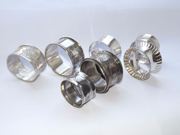 EIGHT VARIOUS ANTIQUE VICTORIAN 19TH - 20TH CENTURY SILVER PLATED NAPKIN RINGS