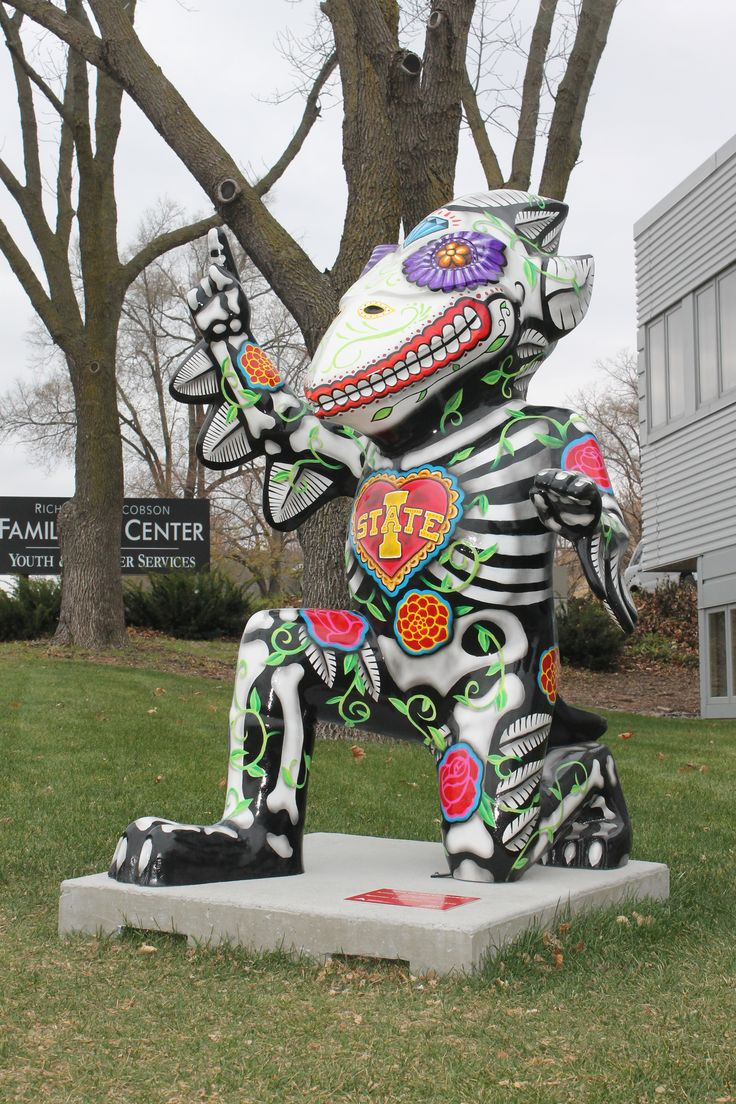 """Dia de los Ciclones,"" a Day of the Dead-inspired Cy, is one of five CyclONE City statues that will be auctioned in December. The statue was painted by Ames artists Hugo Kenemer and Ben Nelson, and currently is located outside the Youth and Shelter Services Family Life Center, 125 S. Third St. Photo by Melissa Erickson/Ames Tribune"
