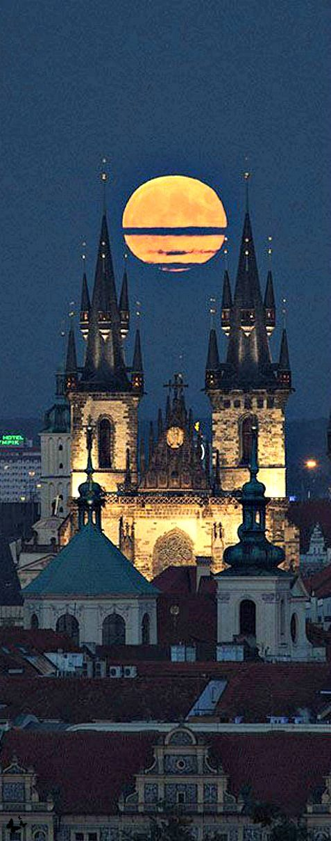 Prague, simply magical castle shining under a full moon gaze.