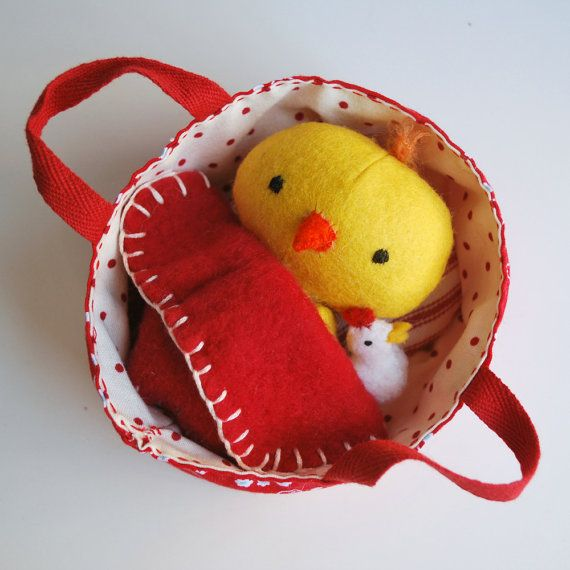 Bitty Birdie in the teeniest baby carrier in my Etsy Shop