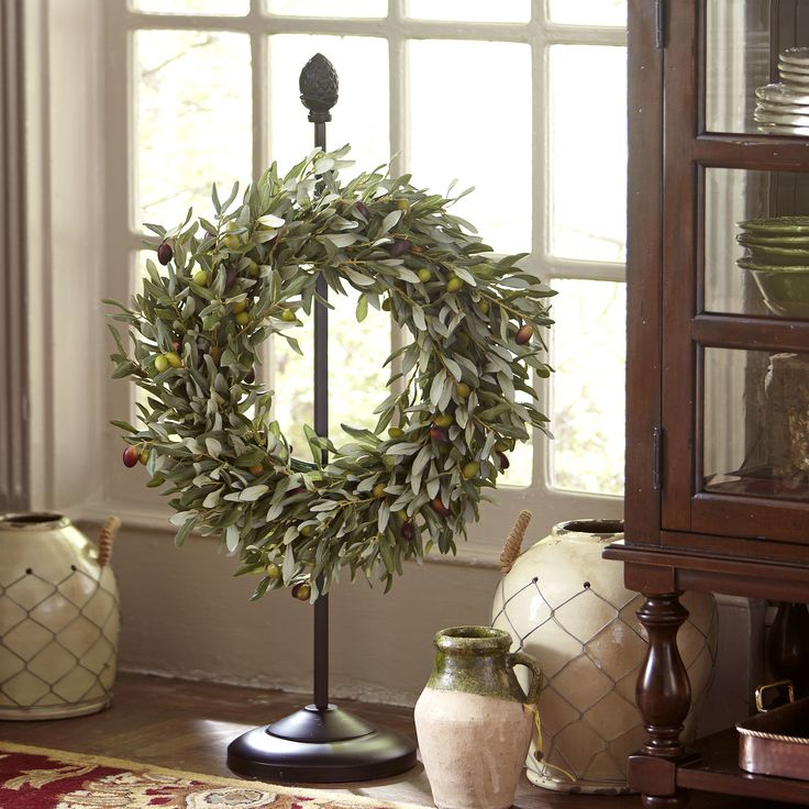 Olive-Branch Wreath | Set a welcoming tone with this hand-finished wreath of faux olive branches, long a symbol of peace.