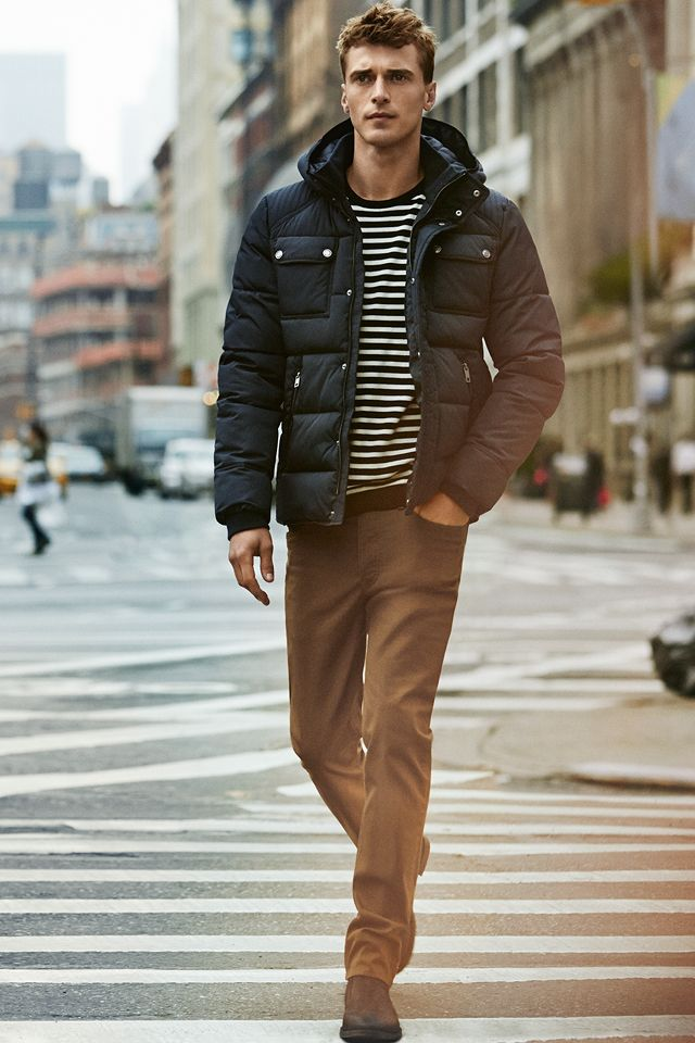 Dark blue padded jacket and striped fine-knit sweater. #HMMEN