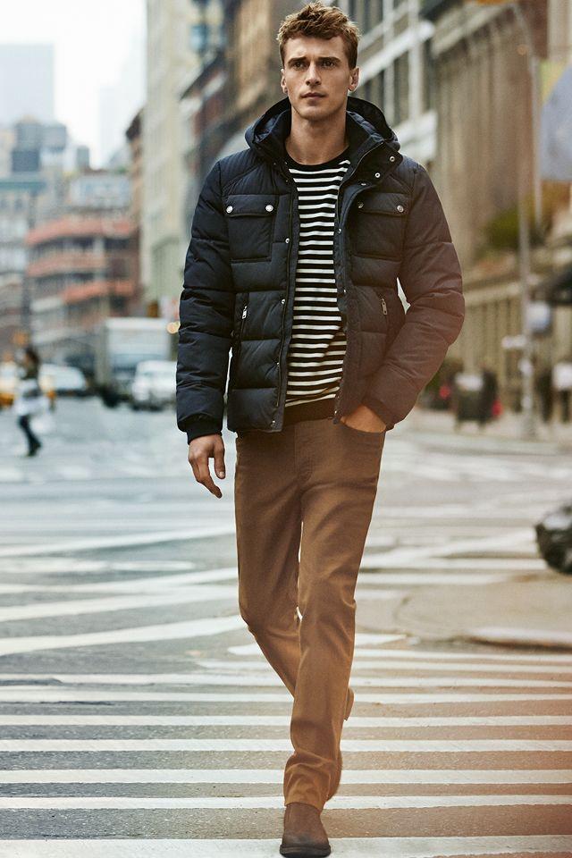 Dark blue padded jacket and striped fine-knit sweater. #HMMEN