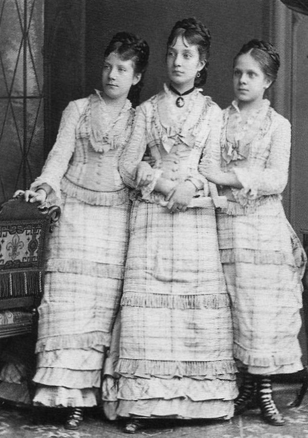 Three beautiful girls in matching dresses.