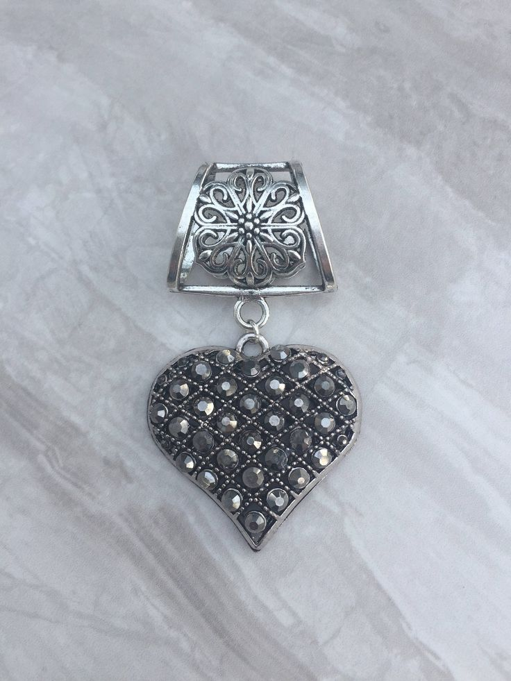A personal favourite from my Etsy shop https://www.etsy.com/uk/listing/257280696/rhinestone-heart-scarf-bail-silver-scarf