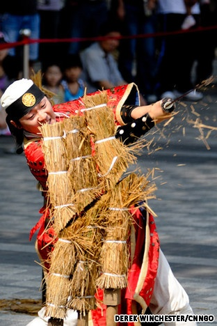 Korean martial artist cutting straw with sword