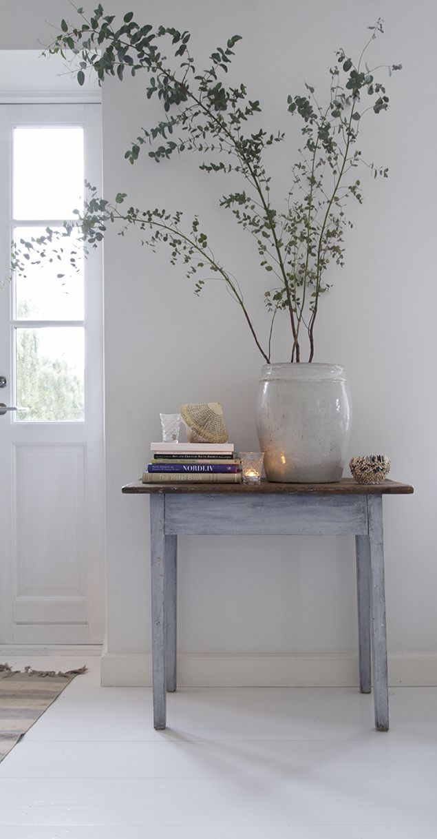 styling with plants, simple styling, rustic table, white walls