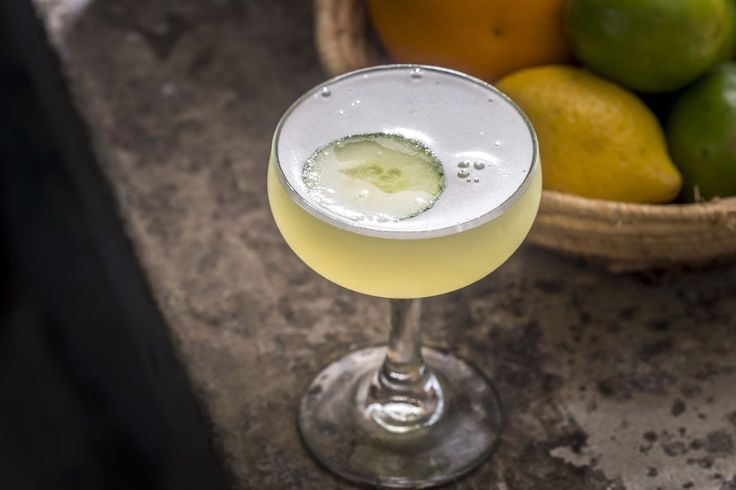 Fresh Cut 2 oz Banks 5 Island rum  .75 oz Lime Juice  .25 oz Green Chartreuse  .25 oz simple syrup  1 sprig epazote  2 thin slices cucumber (plus one for garnish)
